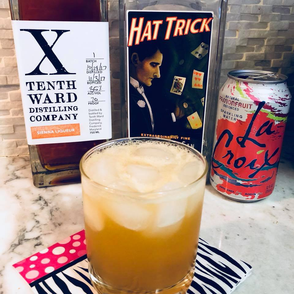 cocktail with tenth ward sienna liqueur, high wire hat trick gin and la croix passionfruit water by frederick md chef chris spear