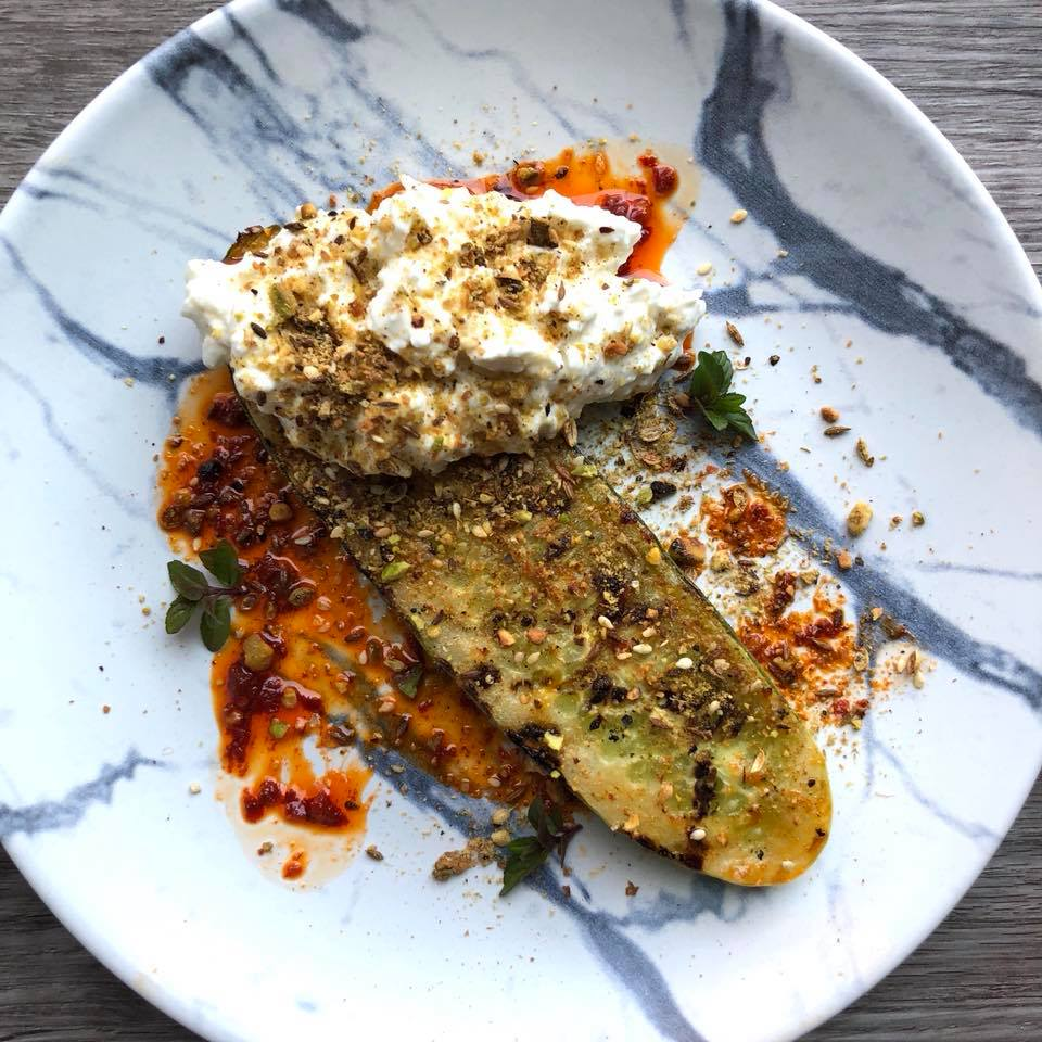 A recipe for Grilled Cucumber, Harissa Oil, Grassmilk Labne/Feta Spread, Pistachio Dukkah & Mint using Row 7 cucumber seeds